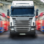 CAR MANUFACTURING ENDS; BUT HEAVY VEHICLES ROLL ON.